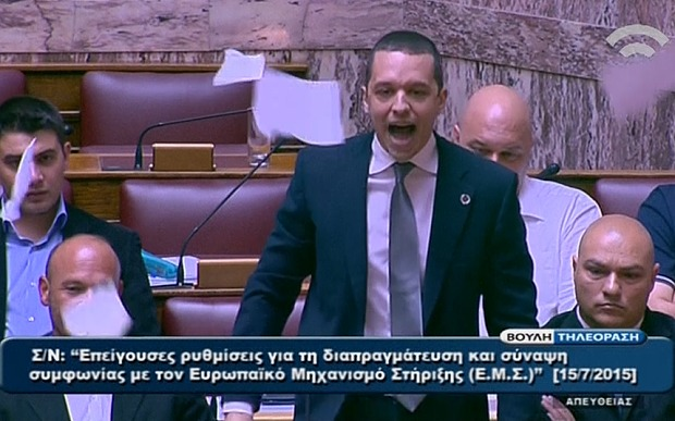 Golden Dawn MP Furiously Tears up Papers in Parliament over Bailout Deal